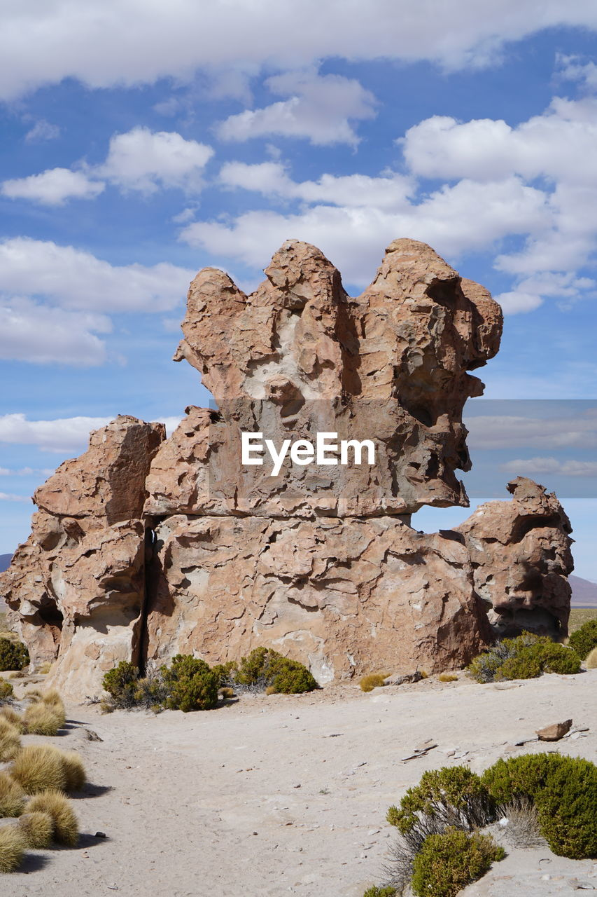 rock, cloud - sky, rock formation, solid, sky, rock - object, nature, physical geography, no people, beauty in nature, geology, scenics - nature, day, tranquility, tranquil scene, non-urban scene, low angle view, rock hoodoo, travel destinations, remote, outdoors, eroded, arid climate