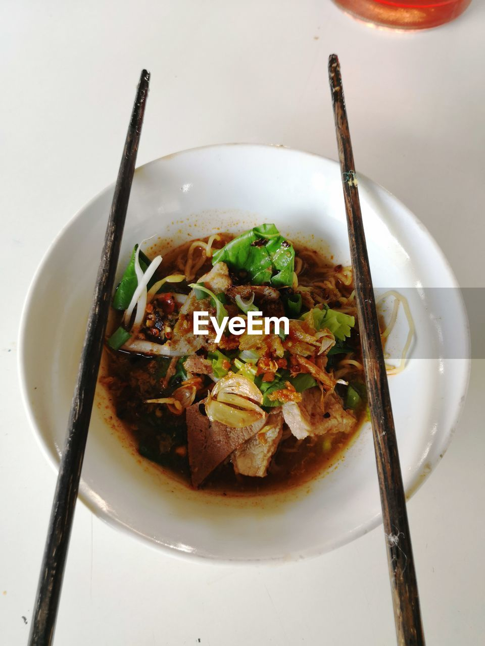 ready-to-eat, food, freshness, indoors, chopsticks, kitchen utensil, food and drink, eating utensil, bowl, healthy eating, spoon, table, no people, close-up, still life, wellbeing, high angle view, serving size, meal, plate, garnish, chinese food, temptation