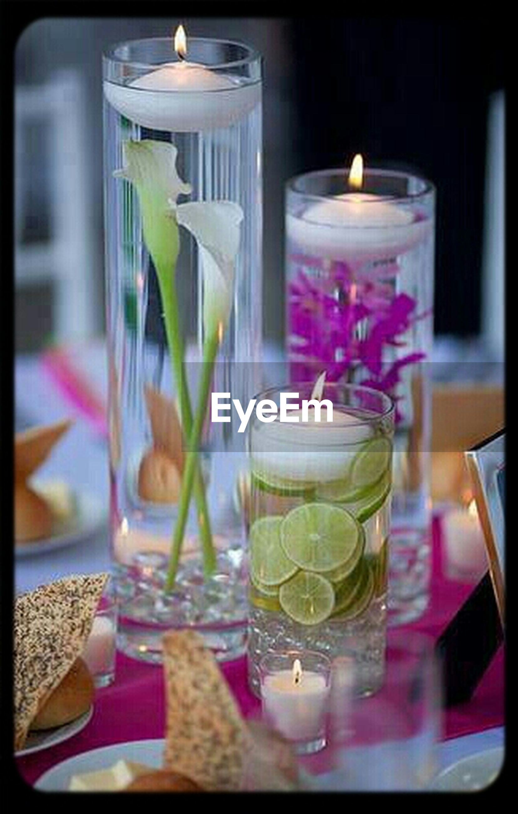 indoors, table, drink, drinking glass, food and drink, glass - material, still life, refreshment, freshness, wineglass, transparent, vase, glass, close-up, restaurant, focus on foreground, alcohol, candle, flower, dining table