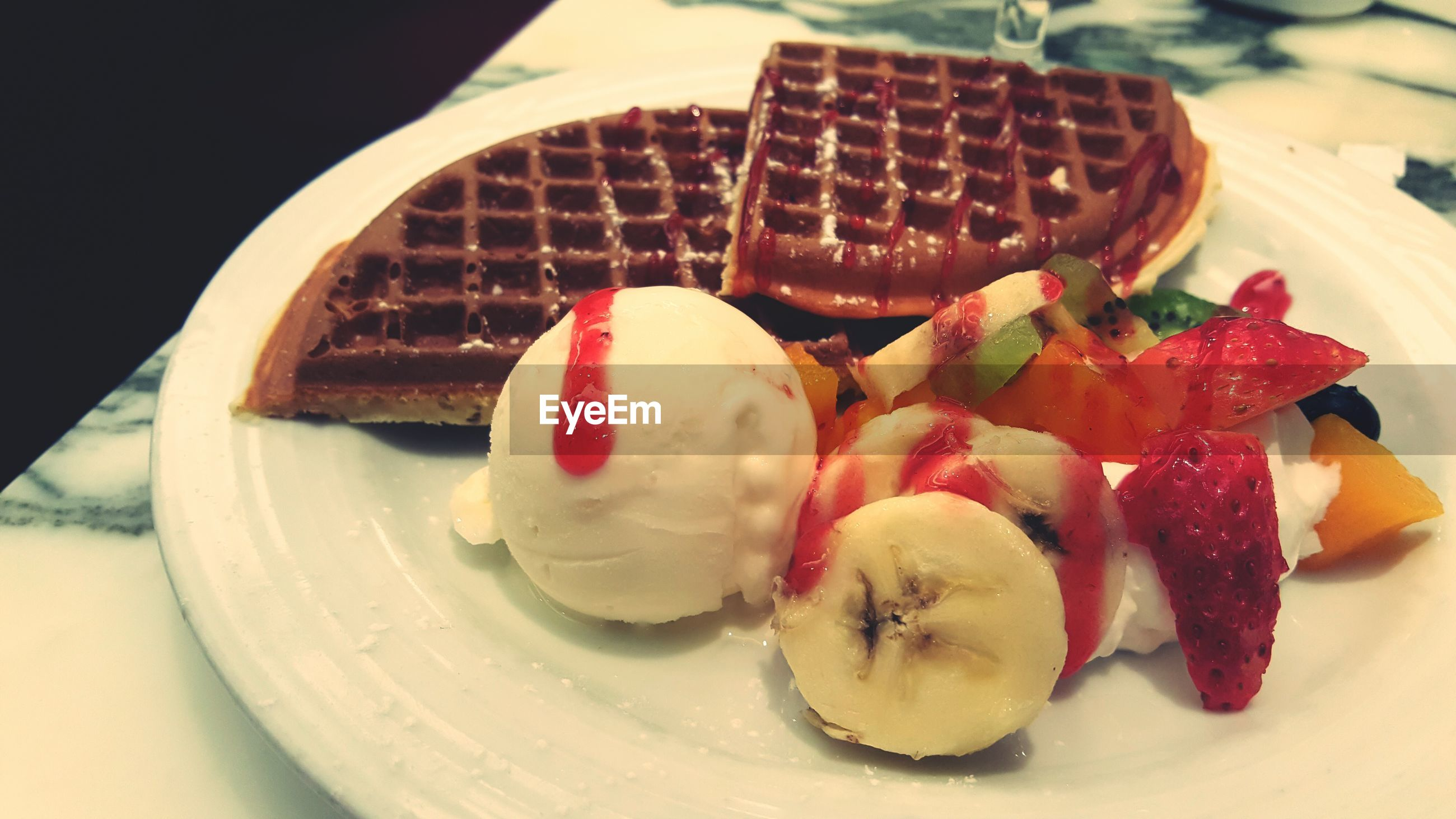 food and drink, sweet food, indoors, food, dessert, freshness, still life, indulgence, ready-to-eat, plate, unhealthy eating, table, cake, close-up, temptation, chocolate, strawberry, high angle view, fruit, ice cream