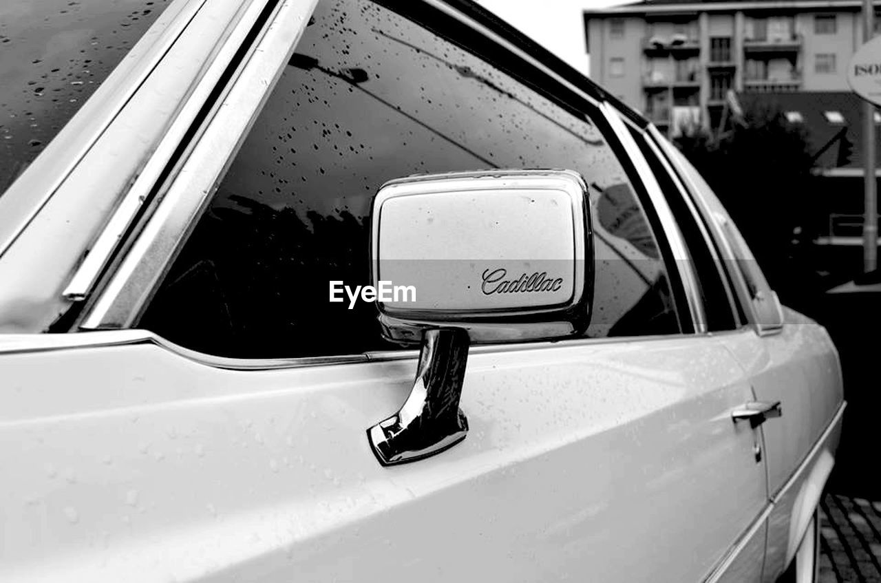 car, land vehicle, mode of transport, transportation, side-view mirror, day, no people, window, outdoors, close-up, built structure, building exterior, architecture
