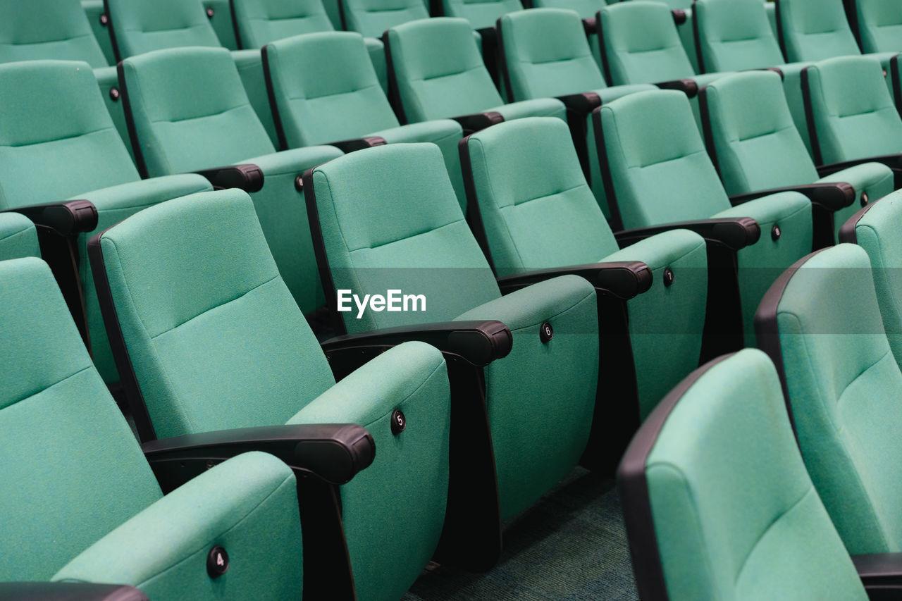Full Frame Shot Of Green Seats At Auditorium
