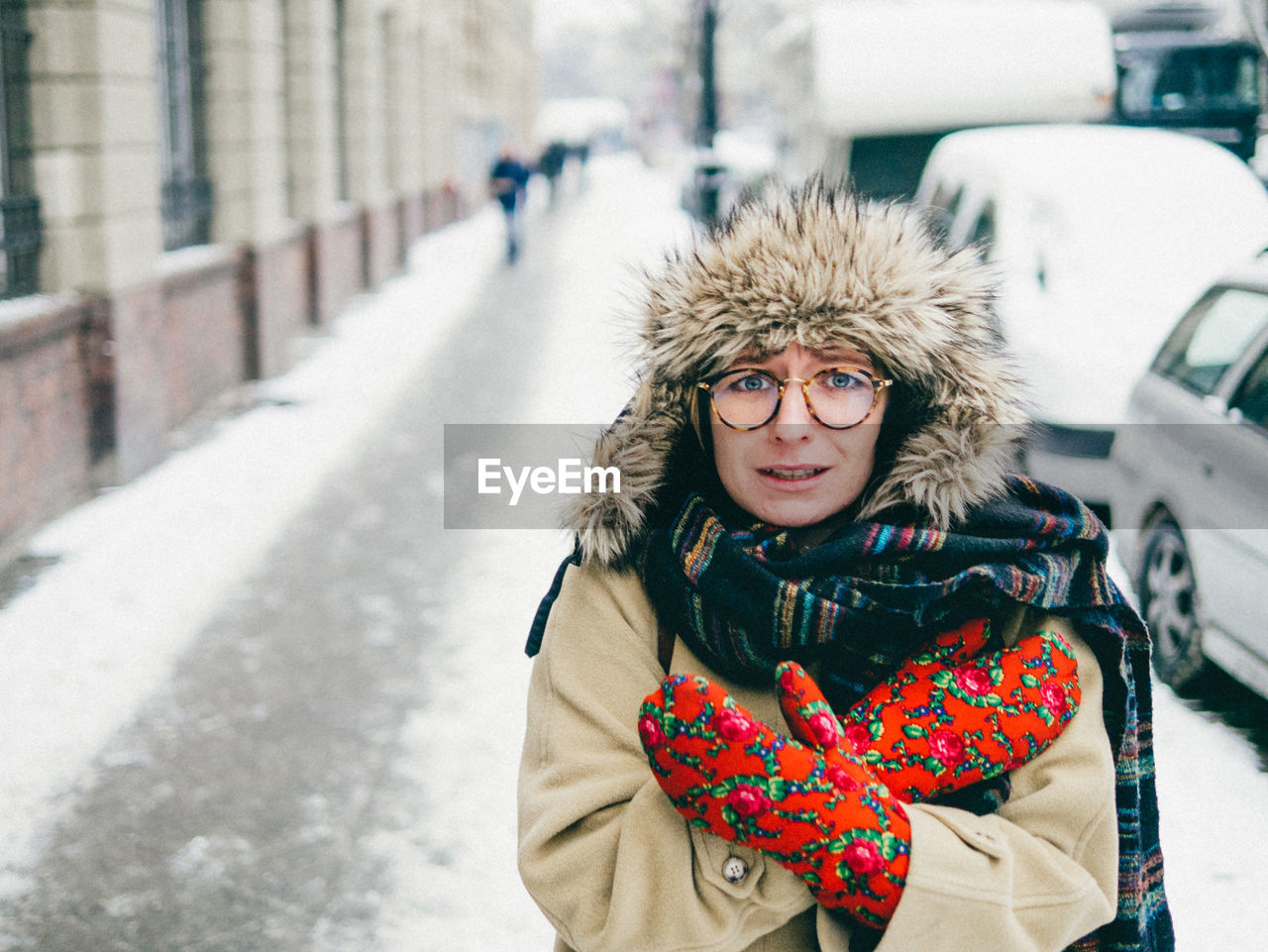 Portrait Of Young Woman Feeling Cold During Winter
