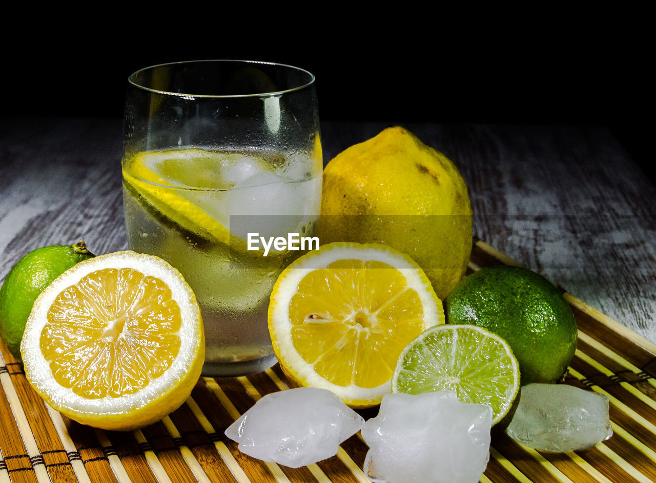 fruit, food and drink, citrus fruit, freshness, food, healthy eating, refreshment, drinking glass, slice, glass, still life, lemon, drink, wellbeing, household equipment, indoors, table, close-up, no people, cross section, sour taste