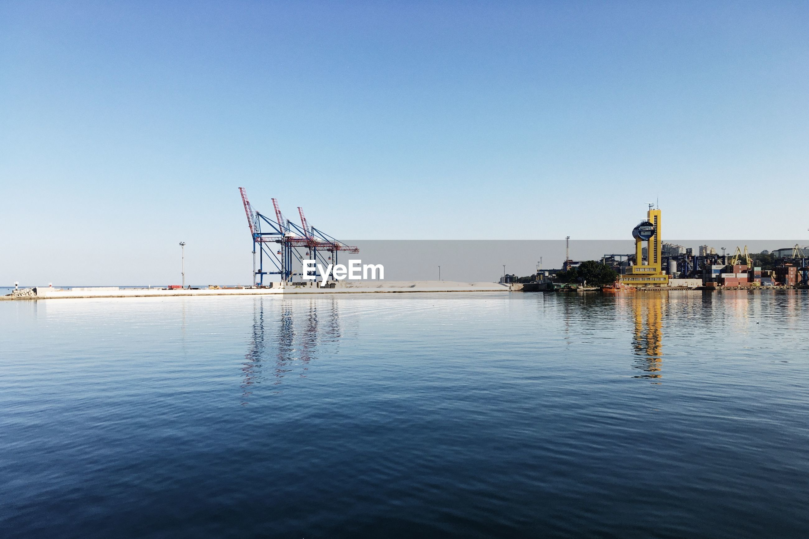 COMMERCIAL DOCK AGAINST CLEAR SKY