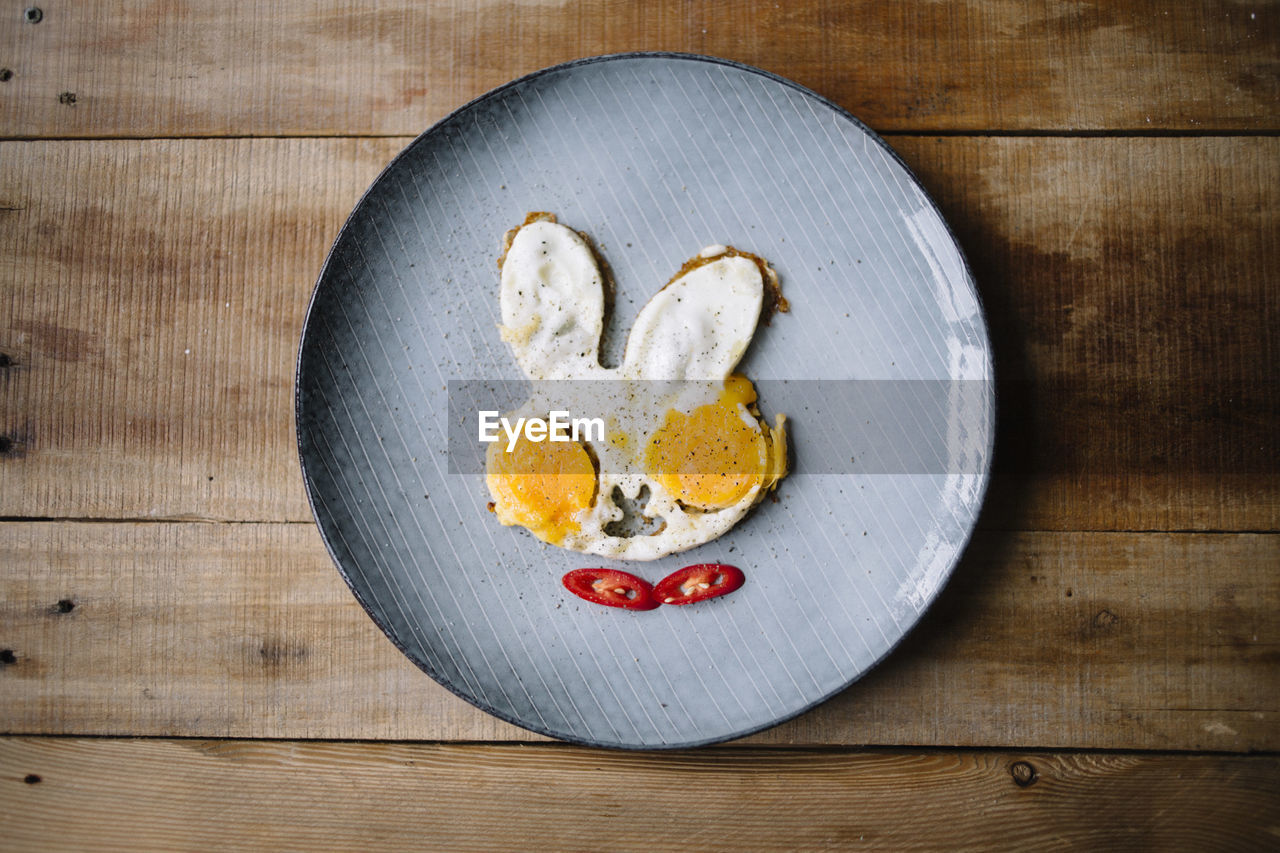 food and drink, food, wood - material, directly above, heart shape, indoors, no people, table, healthy eating, love, positive emotion, emotion, freshness, plate, wellbeing, close-up, wood, still life, shape, wood grain, breakfast