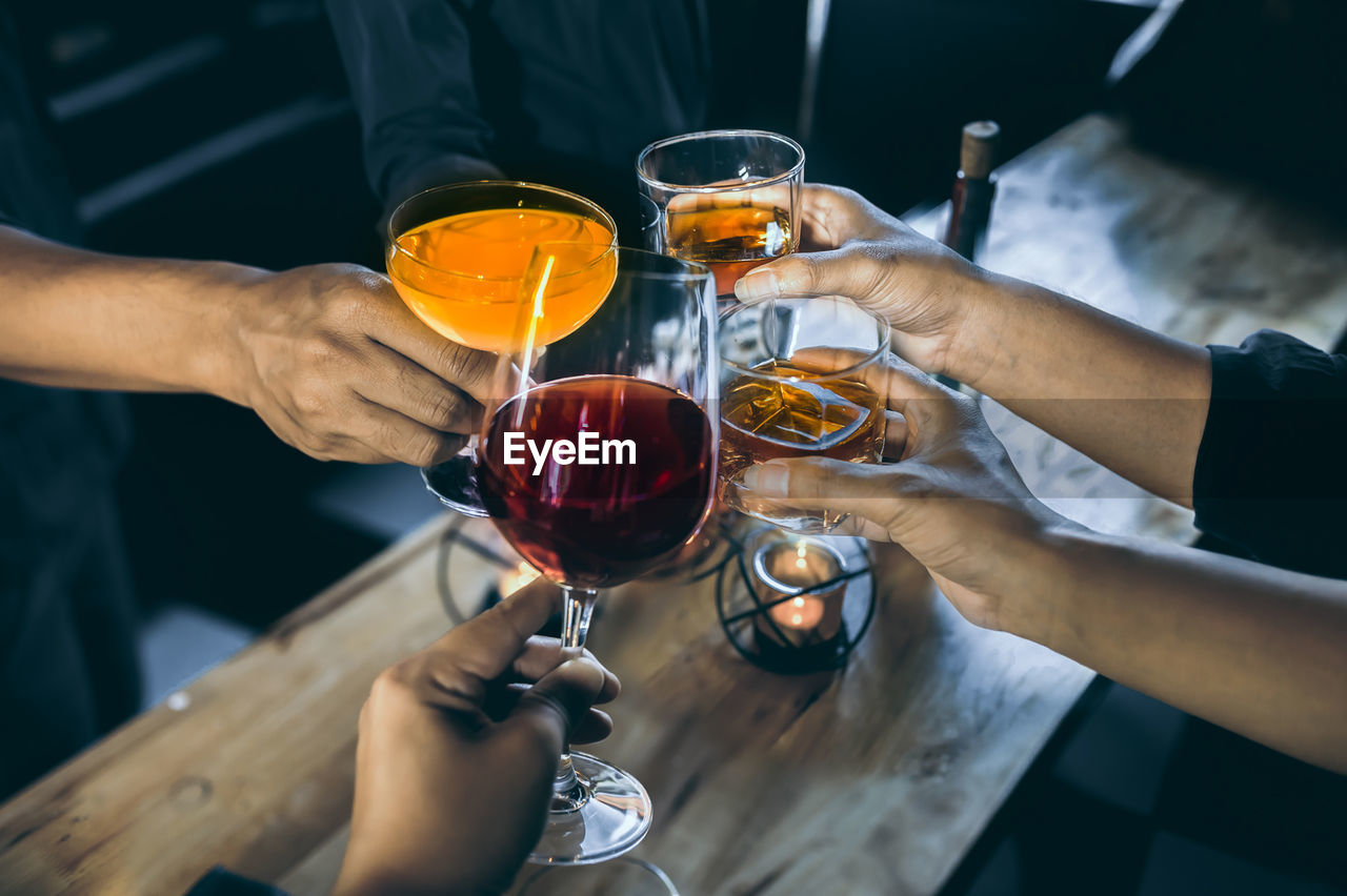 alcohol, drink, refreshment, glass, human hand, hand, food and drink, wine, real people, holding, men, human body part, wineglass, freshness, midsection, business, group of people, lifestyles, indoors, red wine, celebratory toast, drinking