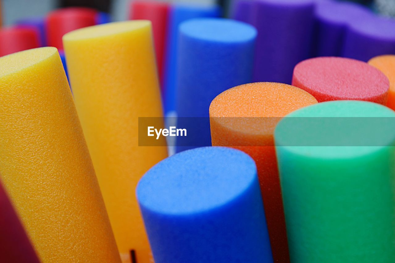 multi colored, close-up, indoors, selective focus, no people, choice, still life, variation, backgrounds, shape, large group of objects, full frame, blue, geometric shape, design, in a row, yellow, arrangement, table, circle, art and craft equipment