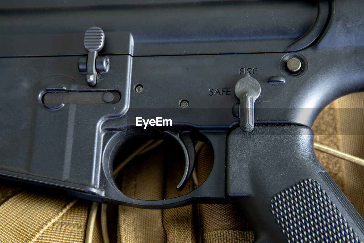 close-up, indoors, no people, metal, gun, still life, technology, communication, machine part, sign, silver colored, mode of transportation, transportation, high angle view, machinery, crime, directly above, weapon, travel