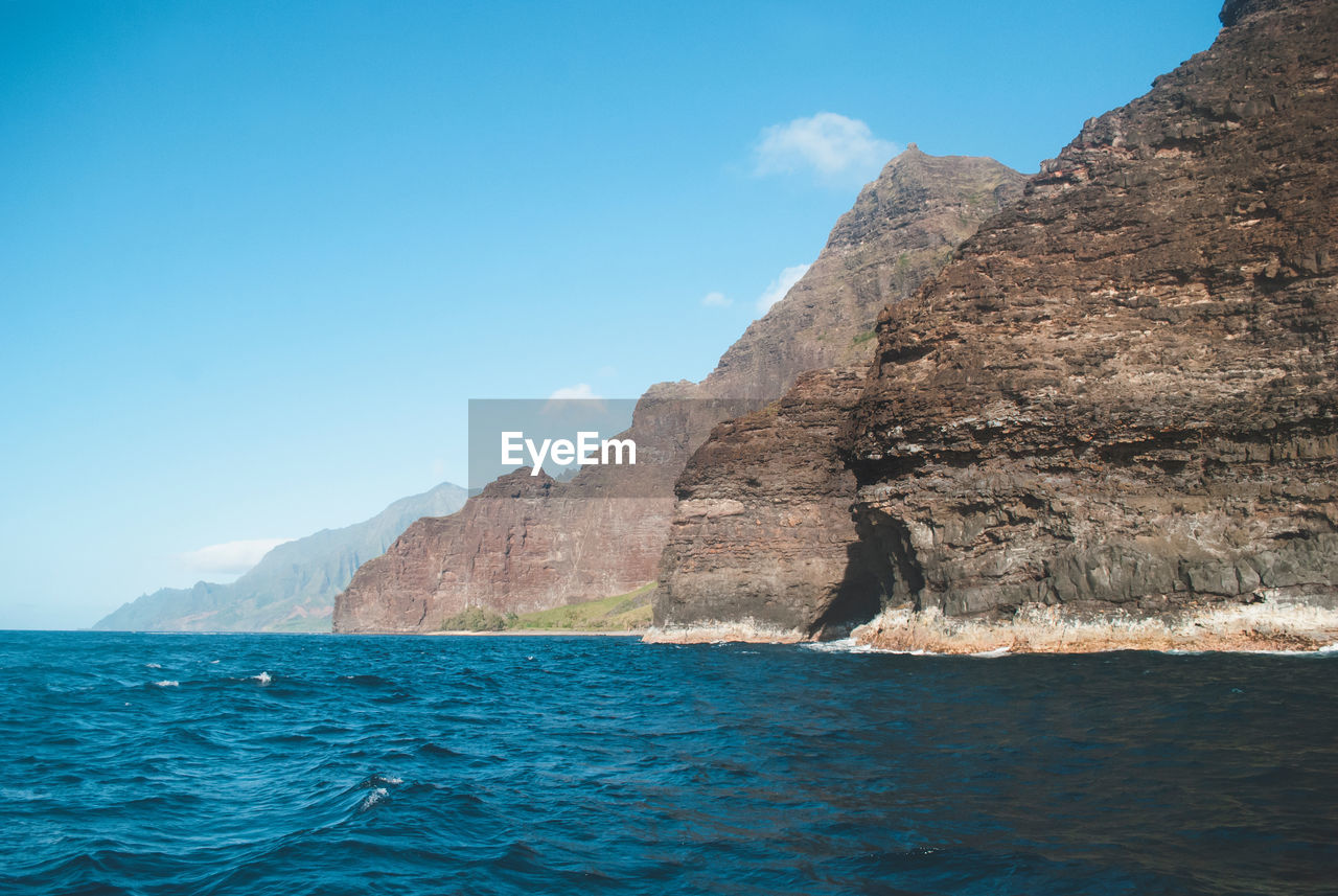 water, sea, sky, waterfront, scenics - nature, mountain, beauty in nature, rock, nature, tranquil scene, rock - object, solid, day, tranquility, no people, blue, rock formation, cliff, non-urban scene, outdoors, formation, marine, eroded