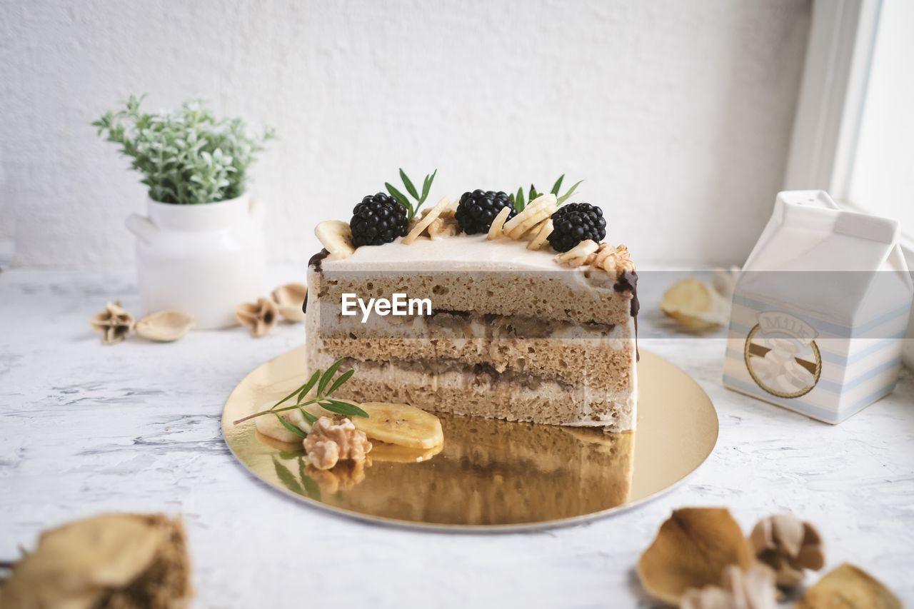 food and drink, food, freshness, indoors, table, still life, no people, sweet food, indulgence, plate, plant, cake, dessert, ready-to-eat, sweet, baked, potted plant, temptation, close-up, nature, herb