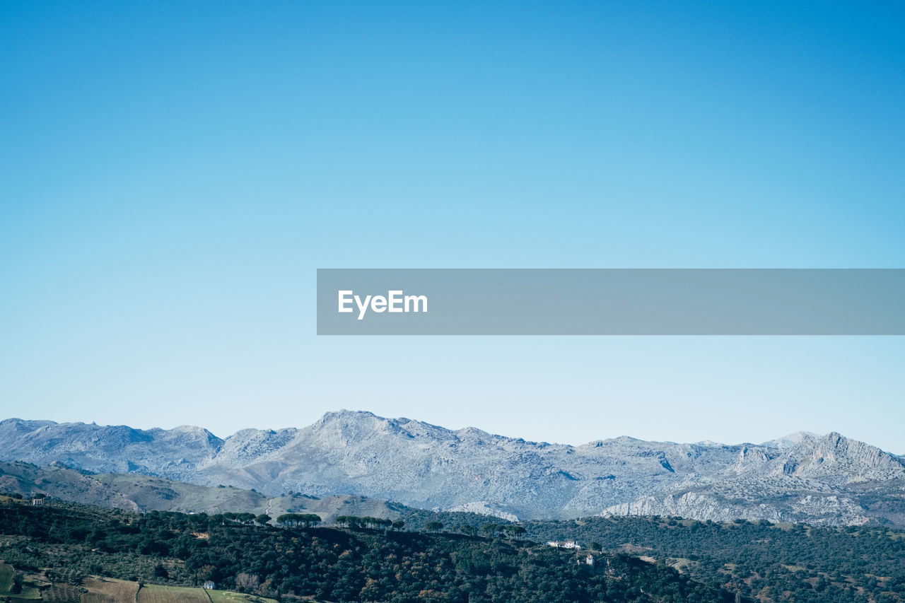 mountain, sky, clear sky, copy space, beauty in nature, scenics - nature, tranquil scene, tranquility, landscape, blue, environment, nature, mountain range, no people, non-urban scene, idyllic, day, remote, outdoors, cold temperature, mountain peak