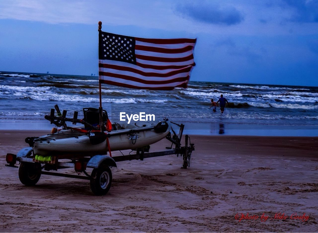 patriotism, flag, striped, sea, stars and stripes, freedom, beach, sky, horizon over water, water, outdoors, transportation, men, nature, real people, day, people