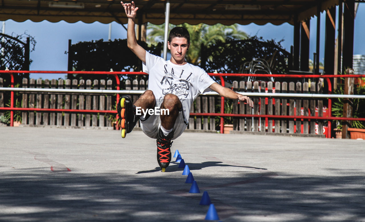 Full length of young man inline skating
