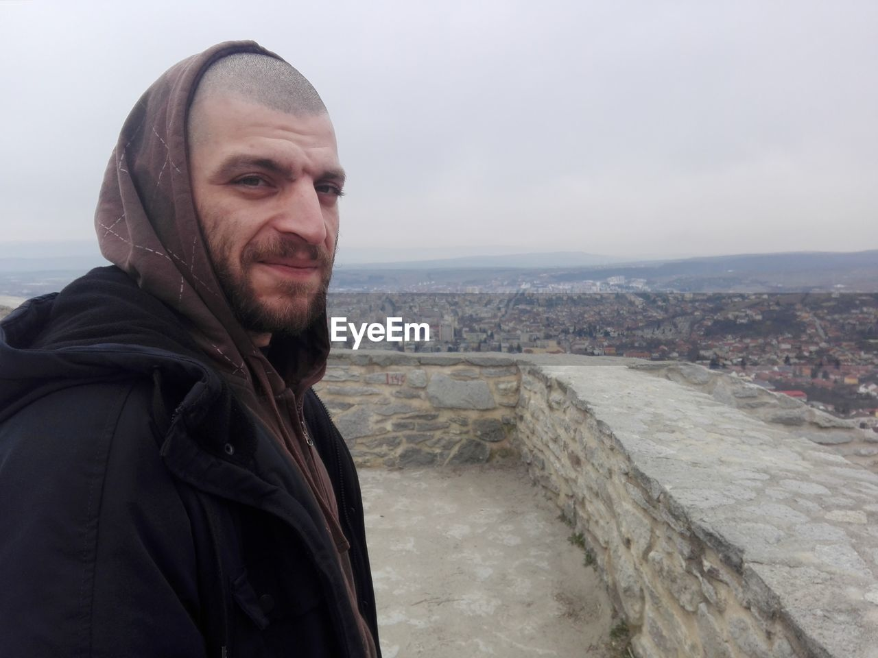 Portrait Of Man Standing In City During Winter