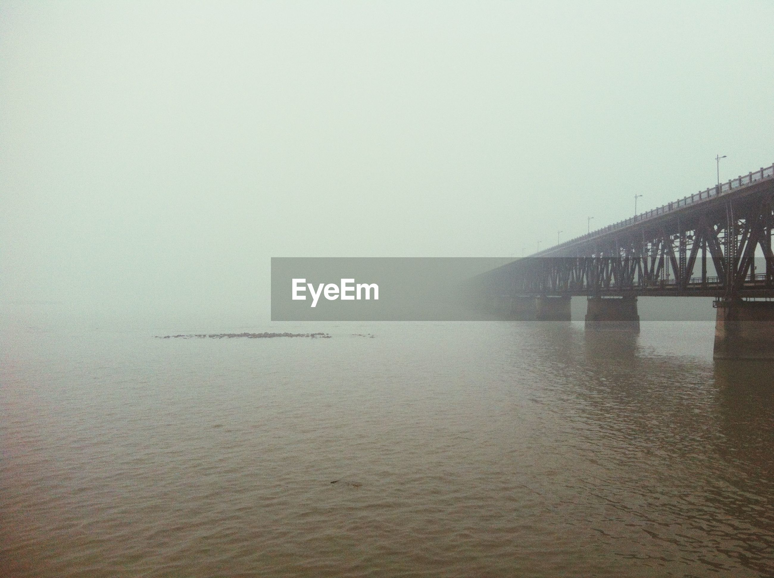 water, sea, waterfront, clear sky, copy space, tranquility, tranquil scene, scenics, nature, beauty in nature, horizon over water, transportation, pier, built structure, sky, idyllic, rippled, reflection, foggy