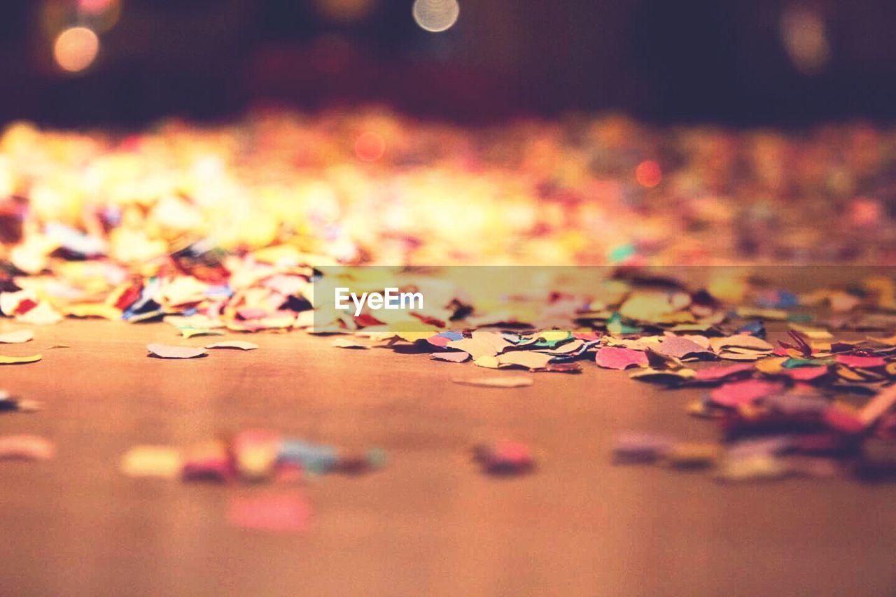 Colorful confetti on floorboard