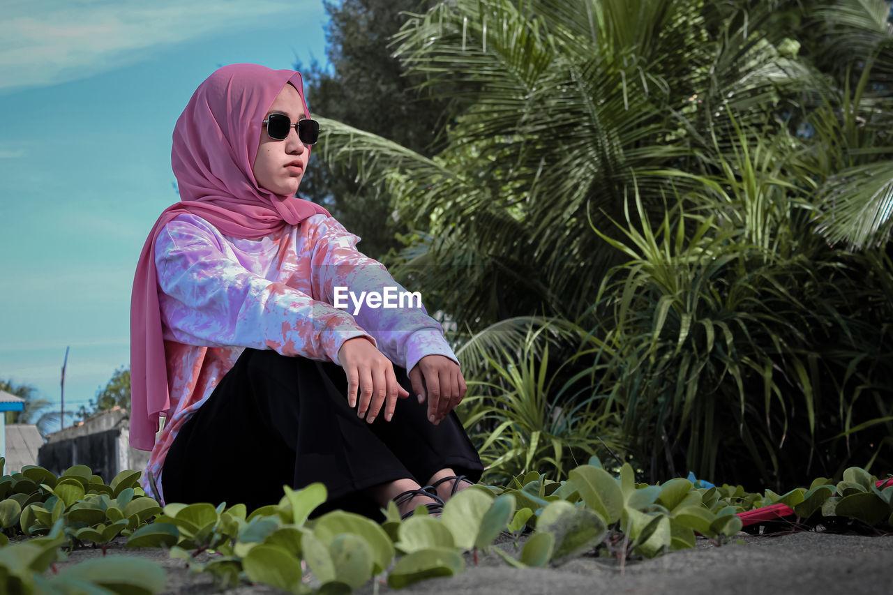 Woman looking at plants