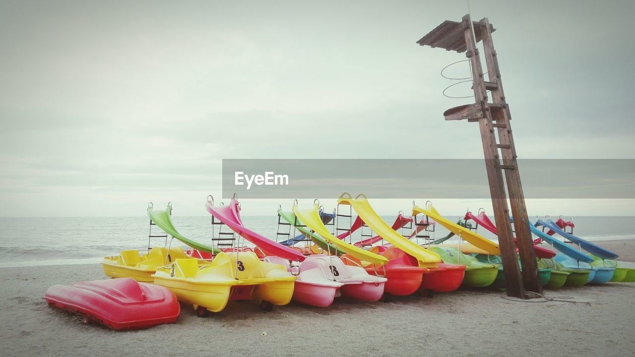 beach, sand, absence, no people, day, multi colored, pair, outdoors, yellow, sky, moored, water, nautical vessel, horizon over water, oar, kayak, beauty in nature, nature