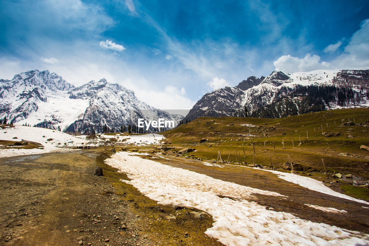 mountain, snow, nature, cloud - sky, scenics, sky, beauty in nature, tranquil scene, cold temperature, mountain range, tranquility, winter, rock - object, day, snowcapped mountain, outdoors, landscape, no people, water