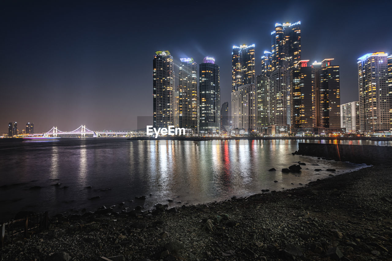 night, architecture, building exterior, built structure, illuminated, water, city, sky, nature, reflection, building, river, no people, office building exterior, waterfront, modern, skyscraper, cityscape, urban skyline, tall - high, outdoors, light, nightlife, bay