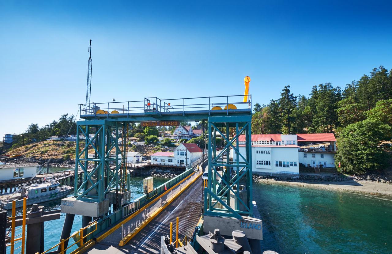 Bridge At Harbor Against Clear Blue Sky
