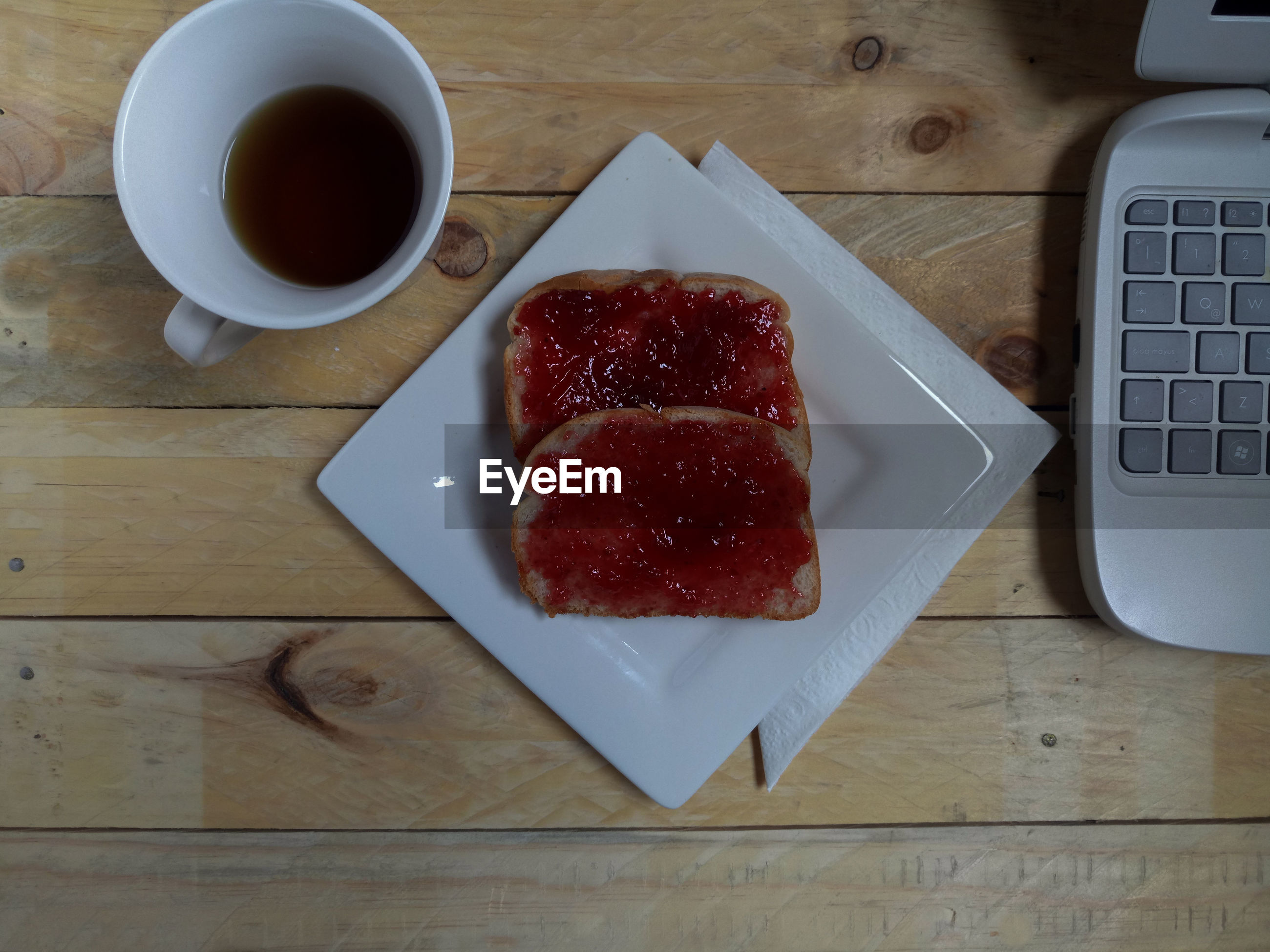 food and drink, table, food, indoors, coffee cup, freshness, bread, no people, high angle view, breakfast, coffee - drink, drink, directly above, technology, close-up, ready-to-eat, day