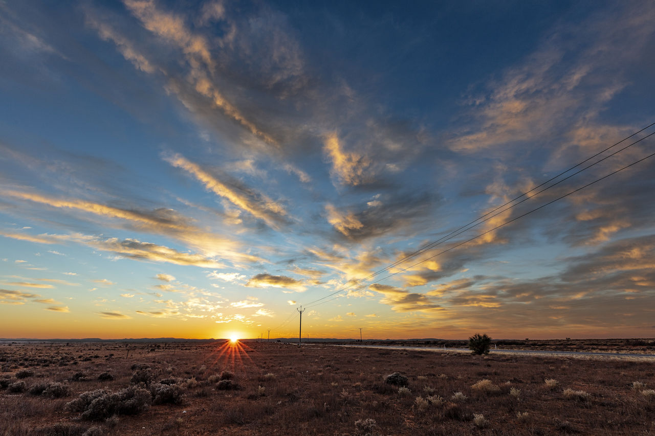 sky, cloud - sky, sunset, beauty in nature, scenics - nature, environment, tranquil scene, land, tranquility, nature, landscape, non-urban scene, horizon, field, environmental conservation, orange color, wind turbine, no people, renewable energy, turbine, outdoors