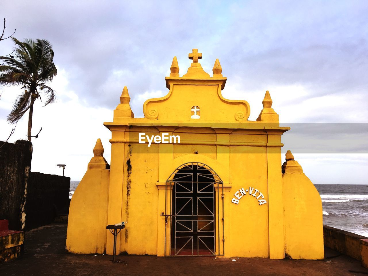 built structure, sky, architecture, building exterior, cloud - sky, yellow, nature, no people, building, day, religion, entrance, outdoors, belief, place of worship, spirituality, the past, history, water, low angle view
