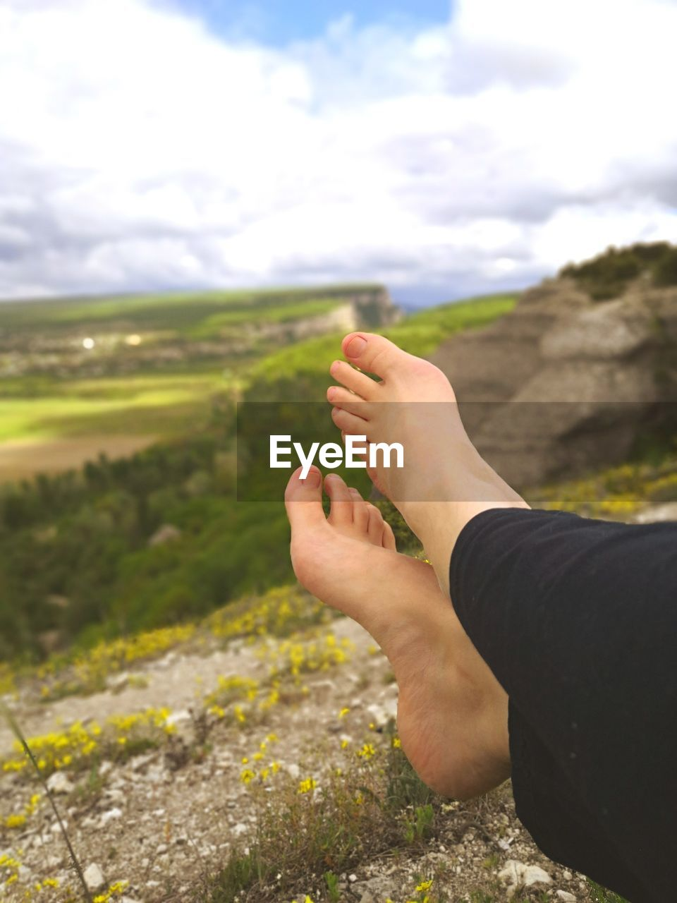 Low section of woman resting on mountain