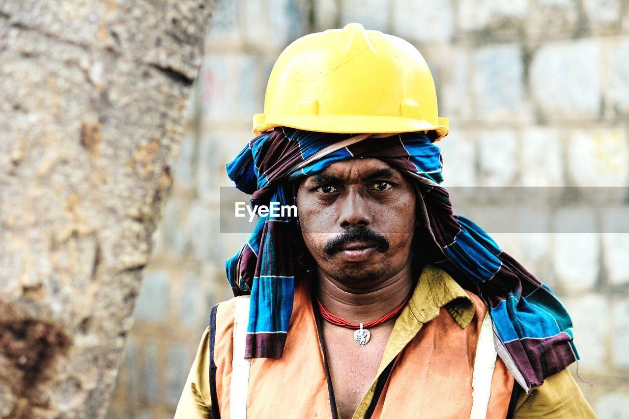Portrait Of Construction Worker Wearing Hardhat