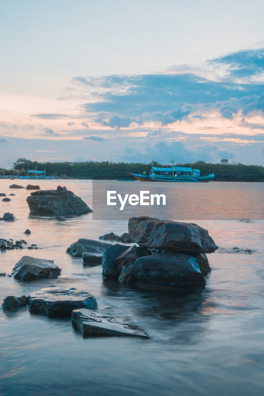 water, sky, cloud - sky, sea, beauty in nature, scenics - nature, waterfront, sunset, tranquility, nature, no people, tranquil scene, rock, idyllic, rock - object, solid, non-urban scene, outdoors, land