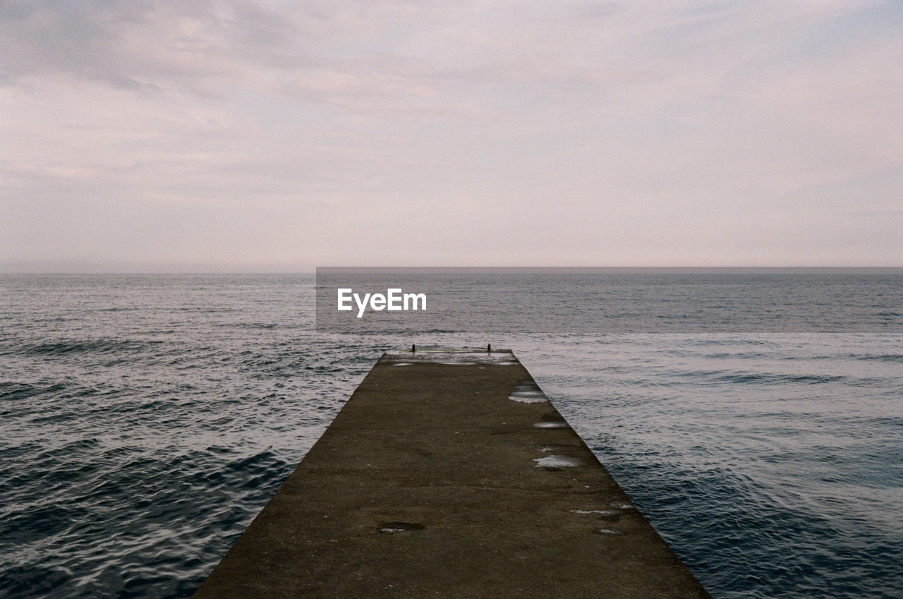 sea, water, sky, horizon, horizon over water, scenics - nature, tranquility, beauty in nature, tranquil scene, no people, nature, pier, direction, cloud - sky, the way forward, sunset, outdoors, idyllic, dusk, groyne, long