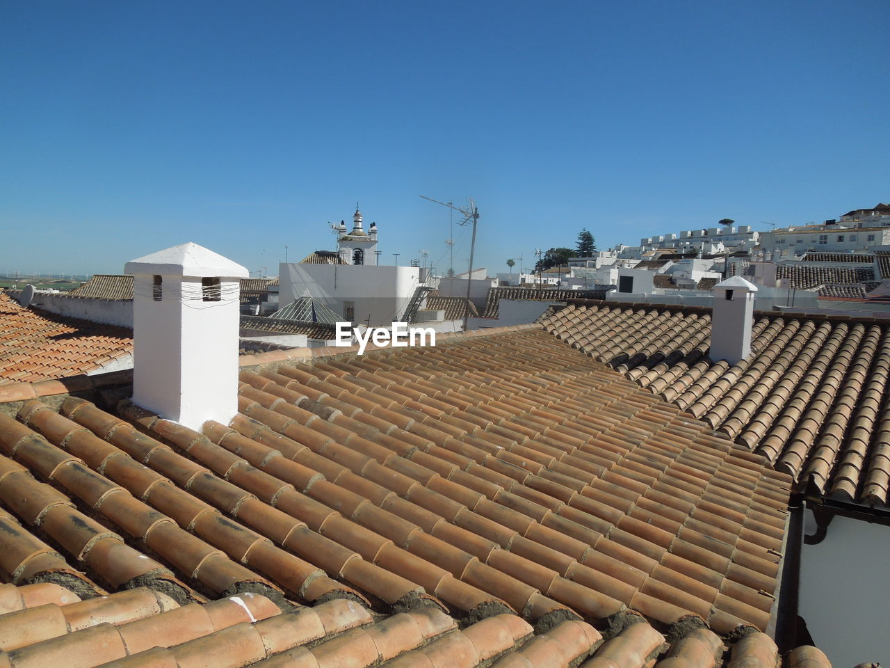 Roofs against clear blue sky