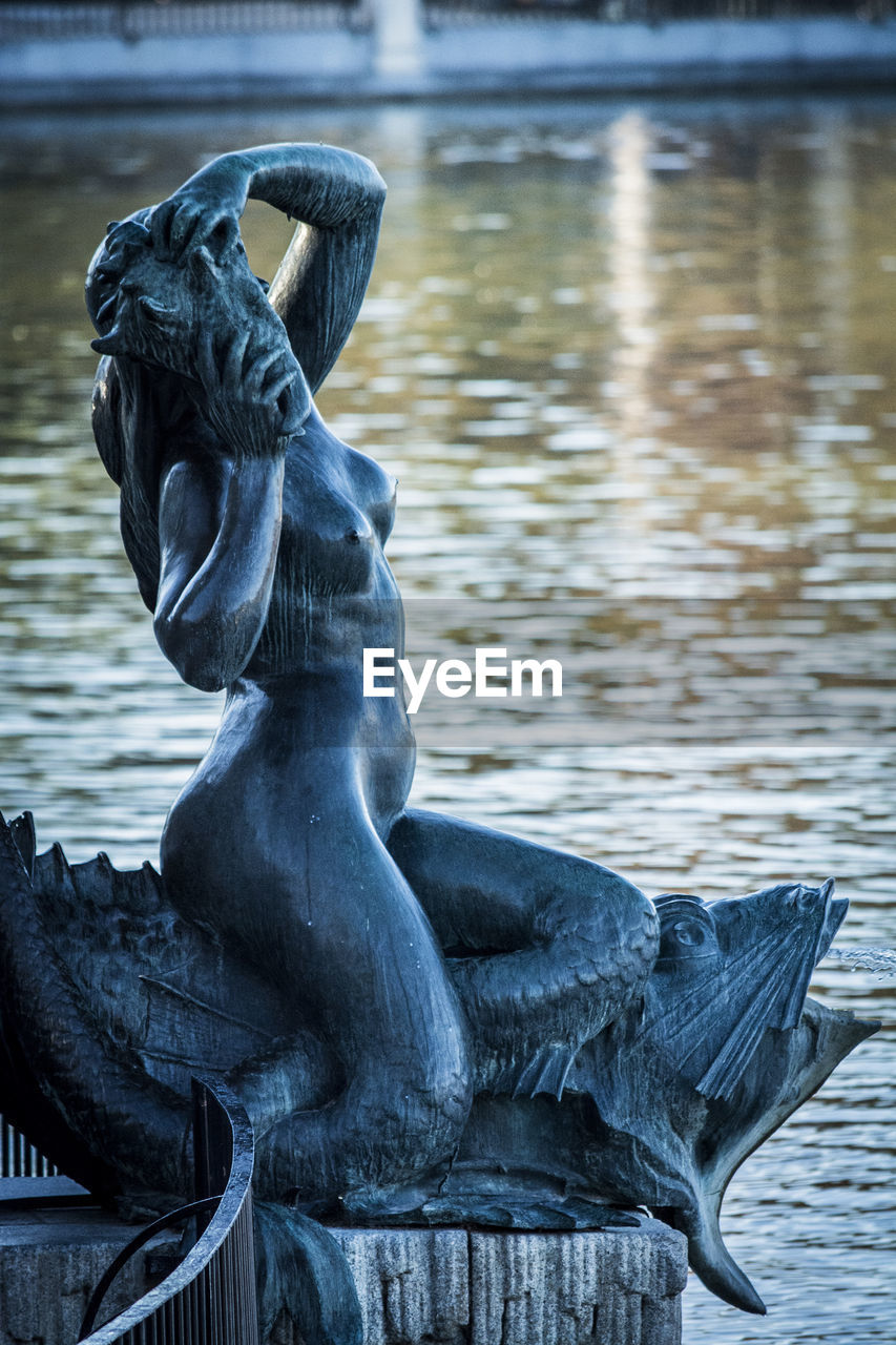 sculpture, statue, art and craft, representation, water, creativity, no people, human representation, focus on foreground, animal wildlife, day, craft, lake, architecture, nature, close-up