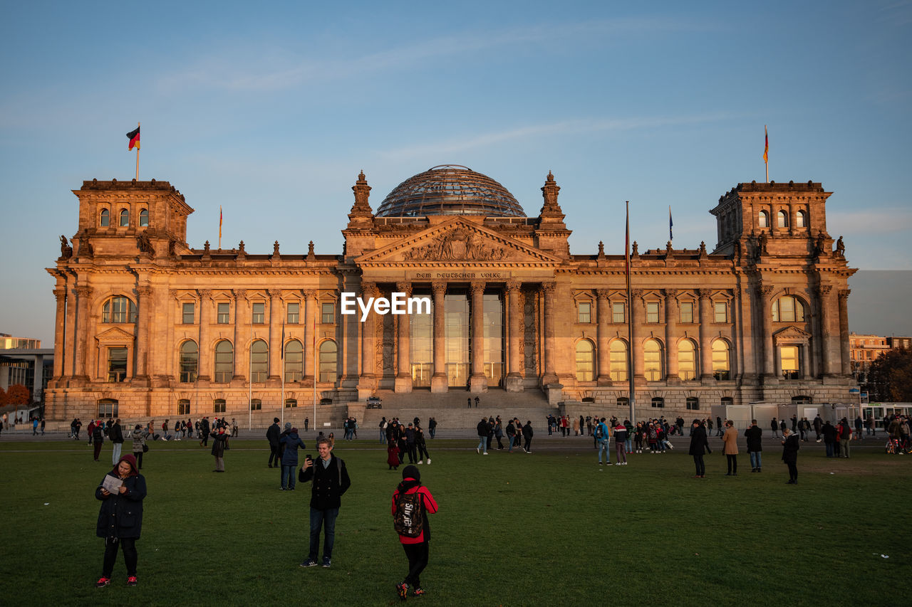 group of people, architecture, built structure, crowd, large group of people, building exterior, real people, travel, tourism, travel destinations, sky, women, leisure activity, men, adult, nature, lifestyles, tourist, city, outdoors