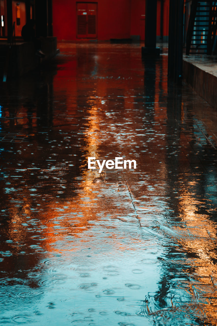 water, reflection, wet, no people, flooring, waterfront, architecture, nature, rain, illuminated, outdoors, built structure, day, rippled, direction, building, pool, rainy season, swimming pool