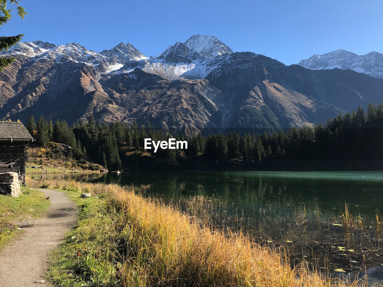 mountain, beauty in nature, tranquil scene, scenics - nature, tranquility, sky, plant, water, lake, mountain range, nature, no people, day, non-urban scene, tree, idyllic, reflection, environment, clear sky, outdoors, snowcapped mountain, mountain peak