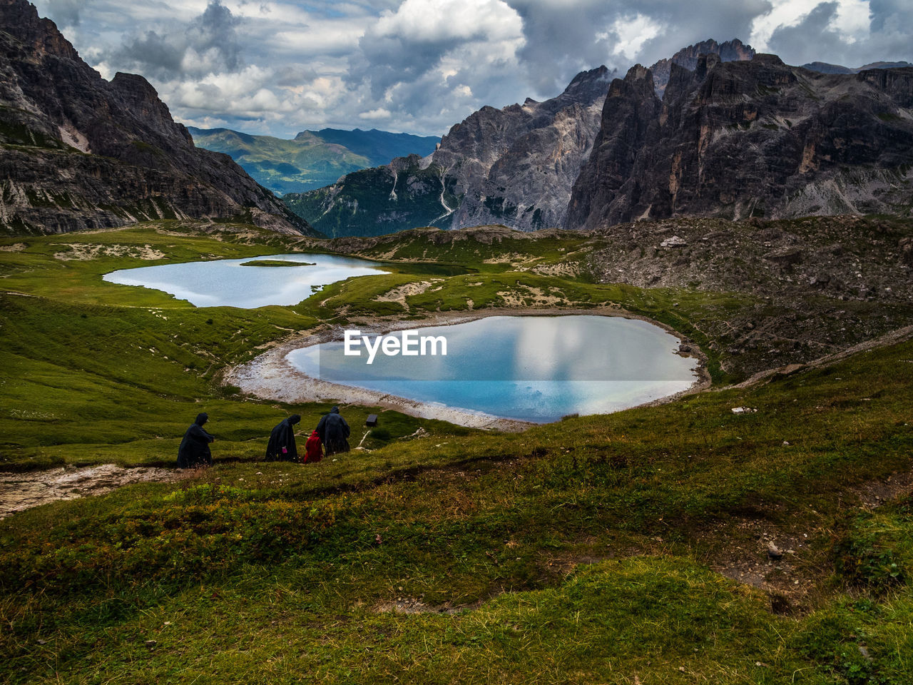 mountain, scenics - nature, beauty in nature, water, leisure activity, lake, nature, day, real people, cloud - sky, hiking, mountain range, sky, activity, environment, people, tranquil scene, non-urban scene, travel, outdoors