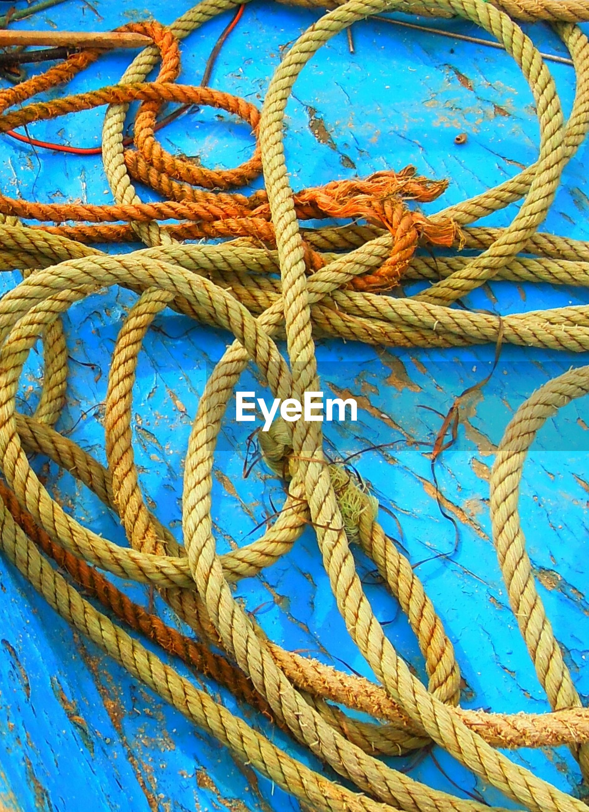 High angle view of ropes on old boats
