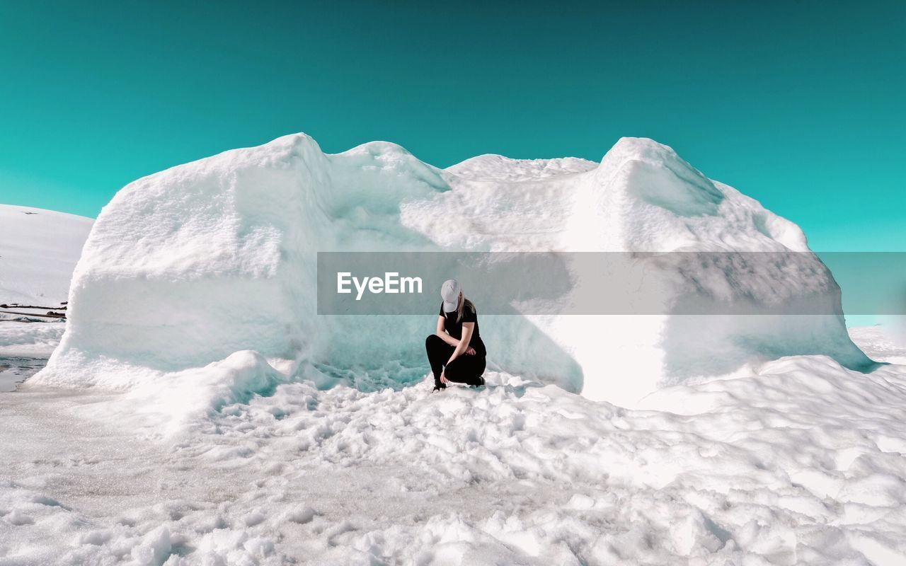 Woman In Snow Against Clear Sky