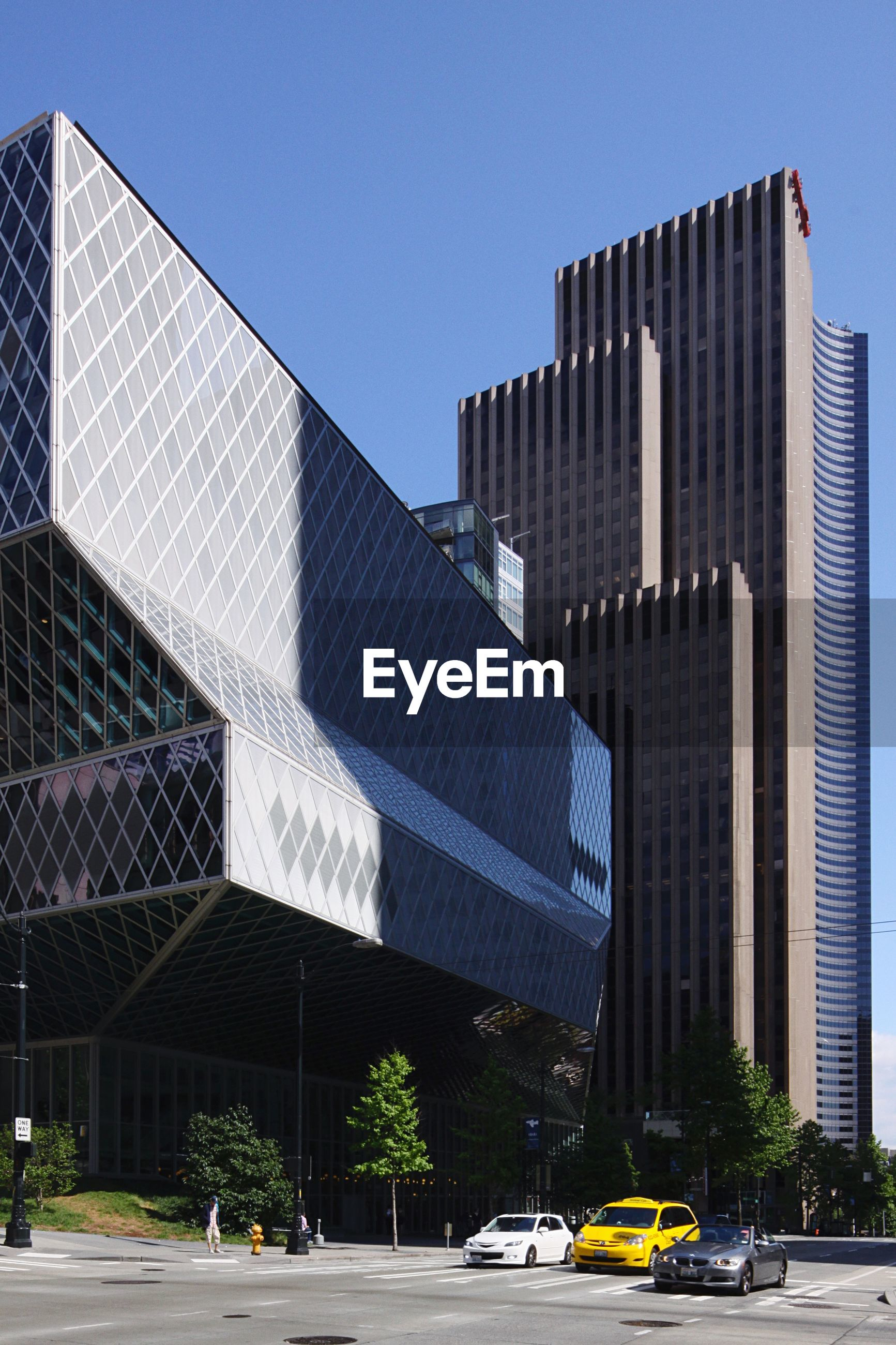 VIEW OF MODERN BUILDINGS AGAINST CLEAR BLUE SKY