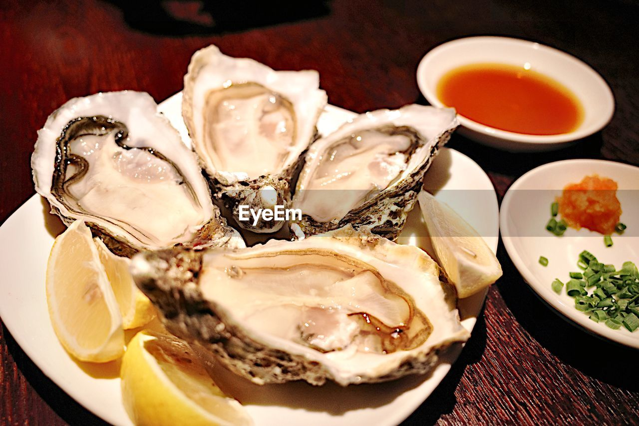 food, food and drink, freshness, plate, still life, table, ready-to-eat, close-up, oyster, indoors, wellbeing, bowl, serving size, no people, healthy eating, seafood, high angle view, indulgence, condiment, sauce, temptation, japanese food, tray, crockery