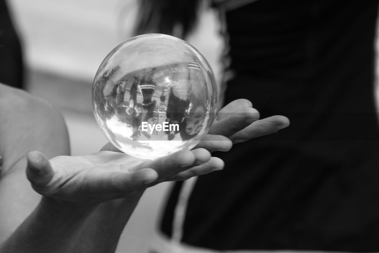 human hand, holding, human body part, sphere, human finger, crystal ball, focus on foreground, real people, one person, close-up, crystal, men, outdoors, day, people