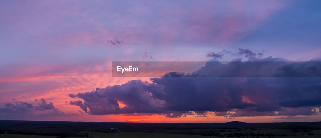 sky, sunset, cloud - sky, beauty in nature, scenics - nature, orange color, tranquil scene, tranquility, environment, nature, idyllic, landscape, no people, dramatic sky, non-urban scene, land, outdoors, field, silhouette, purple, romantic sky