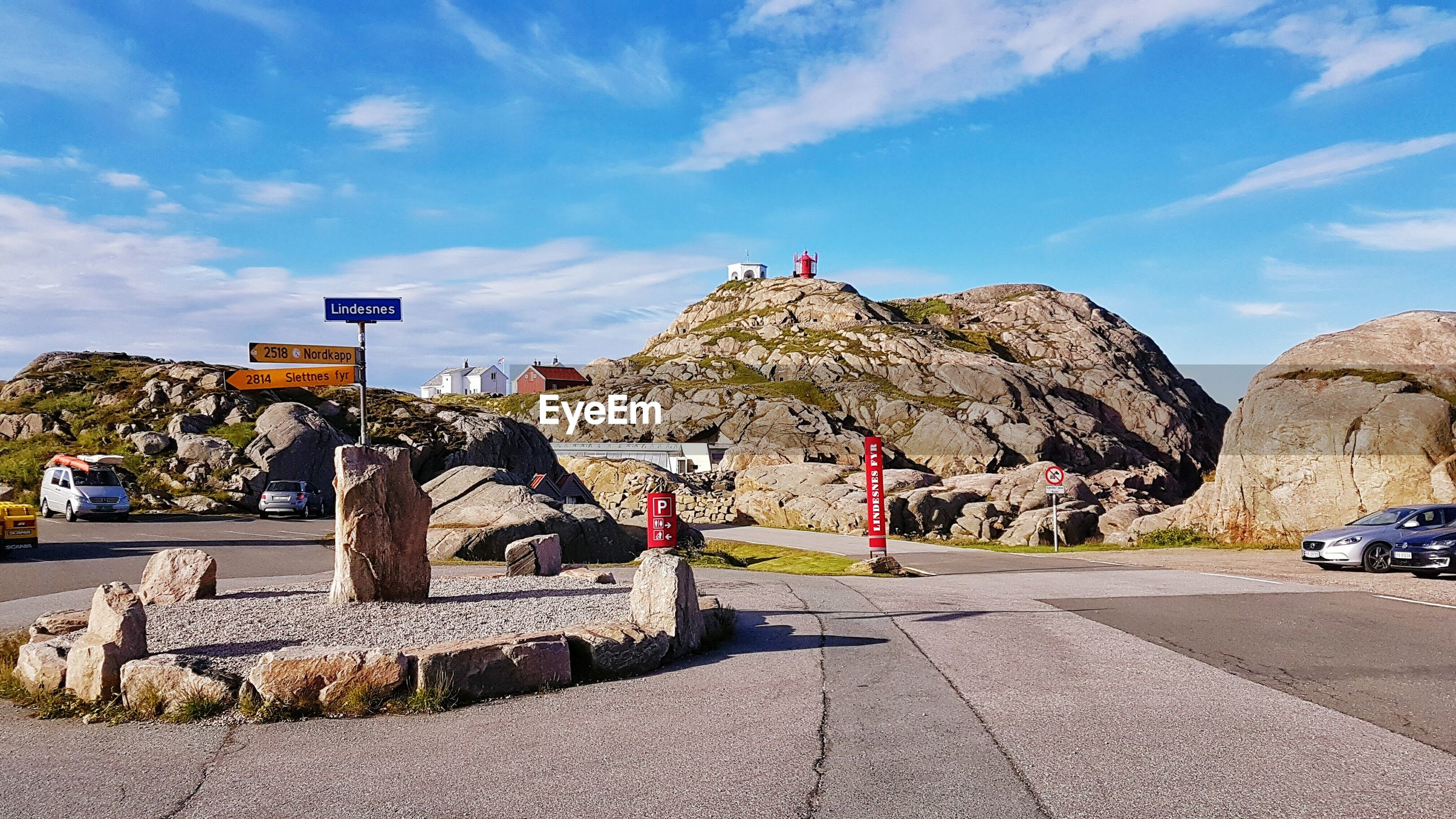 Lindesnes lighthouse on rock formation against sky
