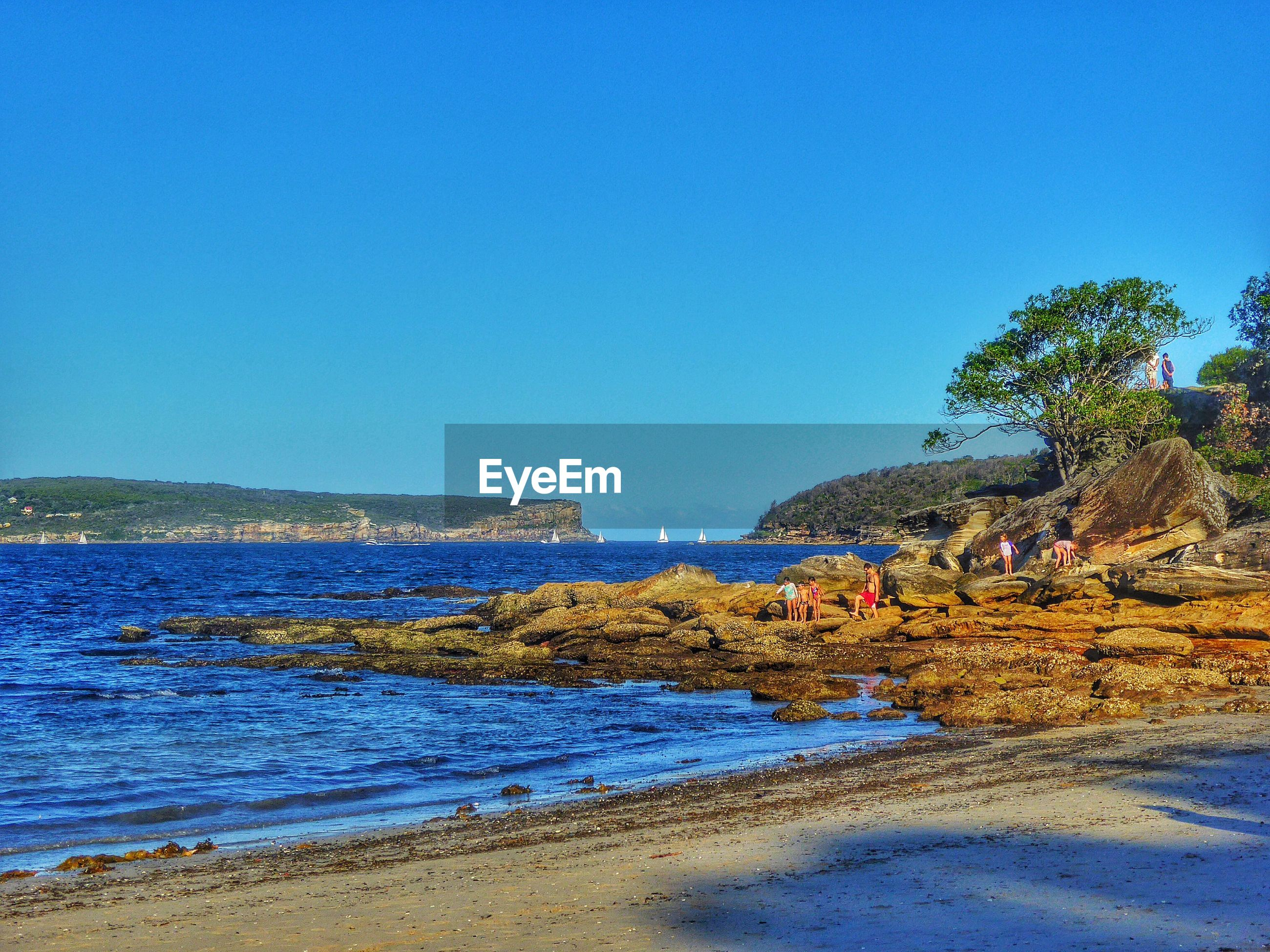 Scenic view of sea landscape against clear sky