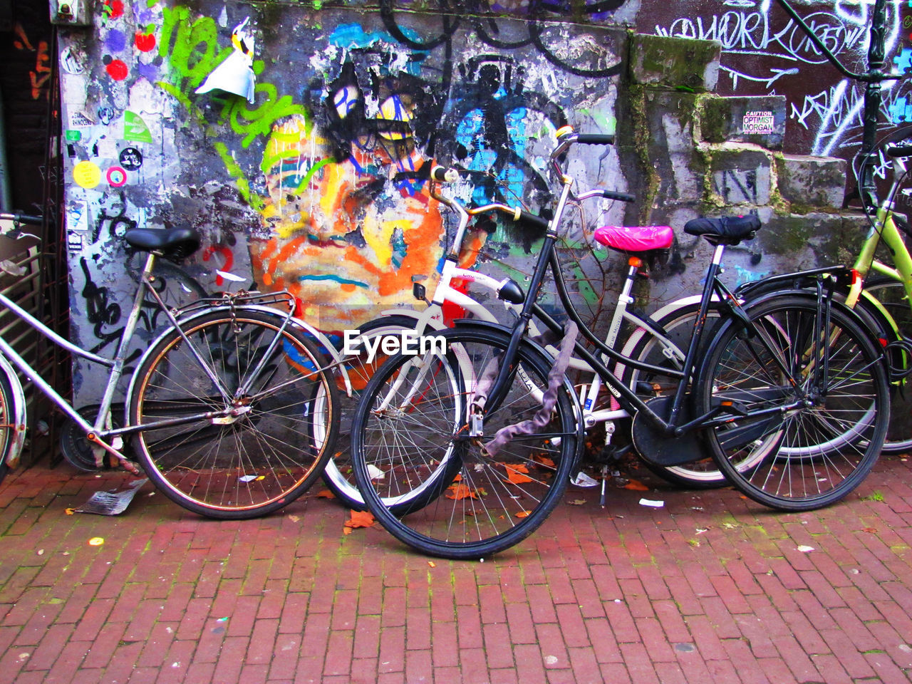 bicycle, transportation, outdoors, stationary, day, multi colored, no people, architecture, close-up