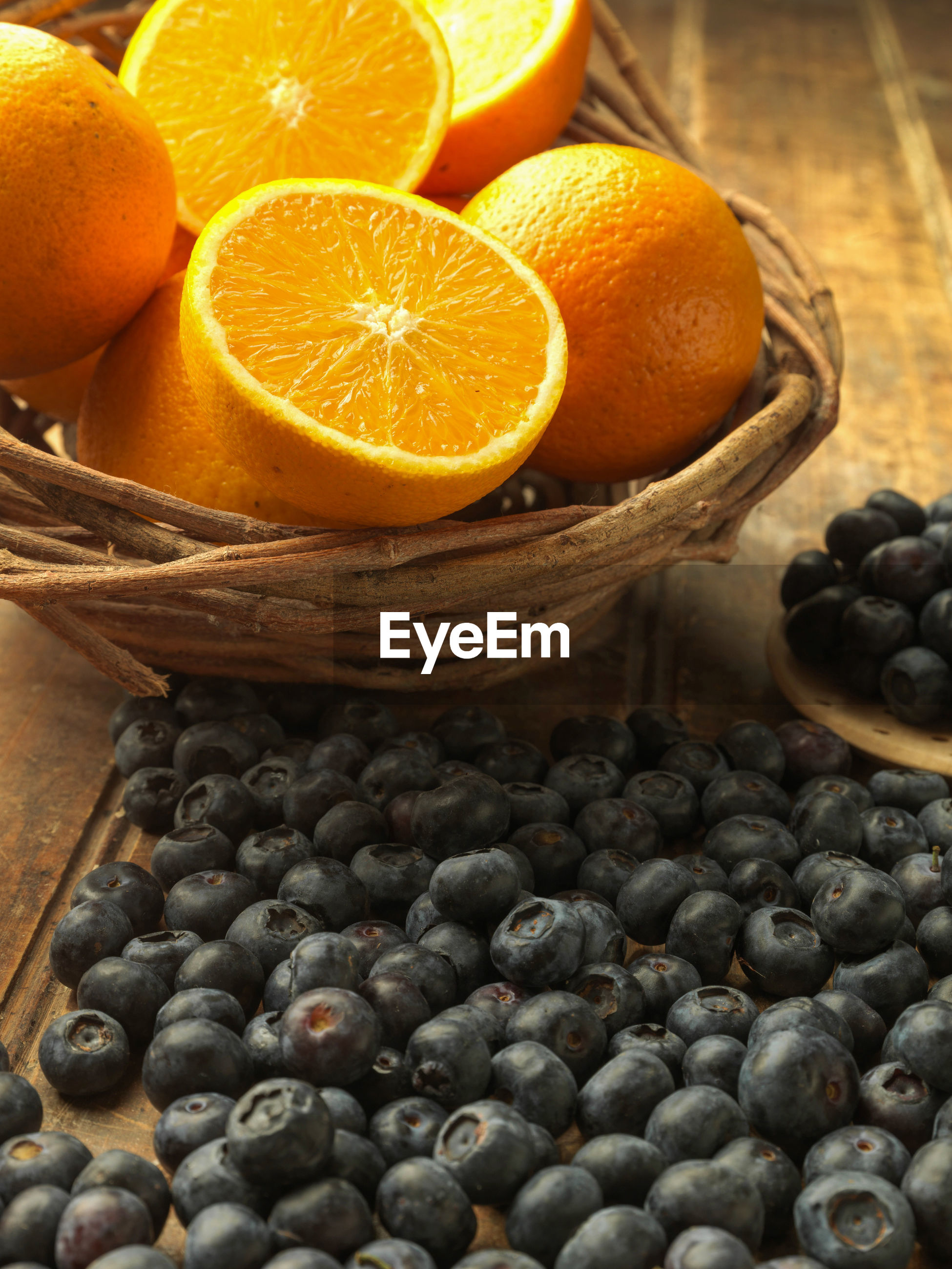 HIGH ANGLE VIEW OF FRUITS IN WICKER BASKET