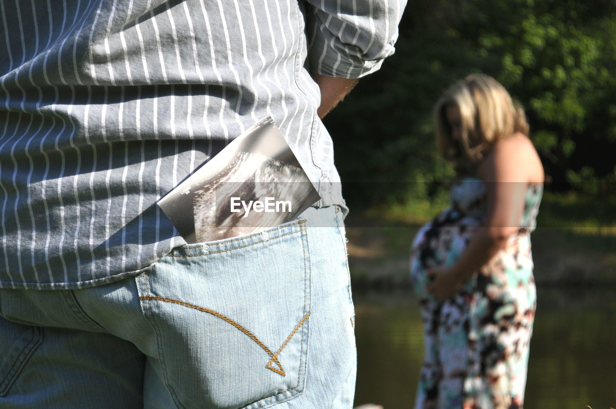 Close-up of man looking at pregnant woman